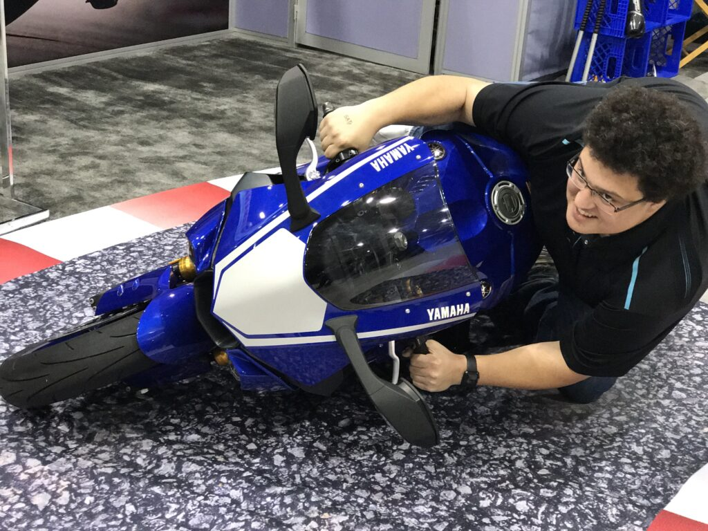 Derek on a stationary R1 at Maximum lean at the Cleavland Motorcycle show.